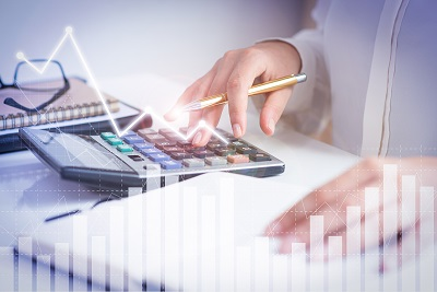 Accountant reviewing and calculating financial documents